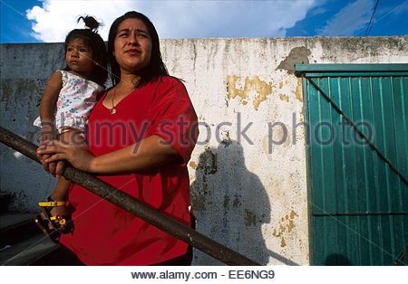 Mexcaltitan, Mother and child watching the basketball match - Stock Photo