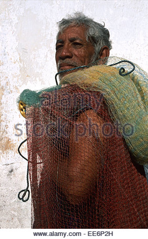 Mexcaltitan, A fisherman carrying his net - Stock Photo