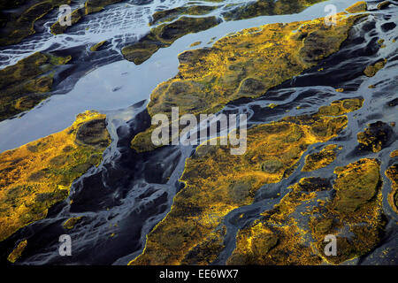 Aerial view of meandering river in moss covered landscape, Landmannalaugar,  Iceland - Stock Photo