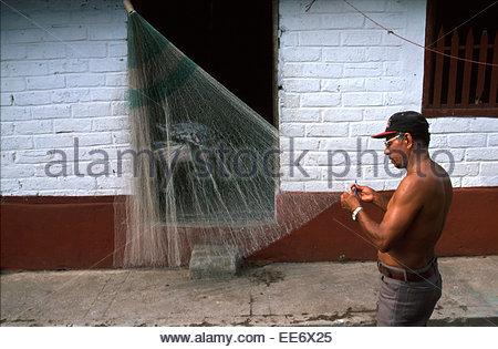 Mexcaltitan, Fisherman repairing net - Stock Photo