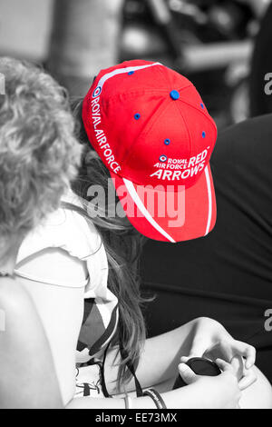 Young lady wearing Royal Air Force Red Arrows baseball cap at Bournemouth Air Festival - Stock Photo