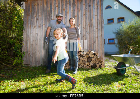 Family in garden having fun, Munich, Bavaria, Germany - Stock Photo