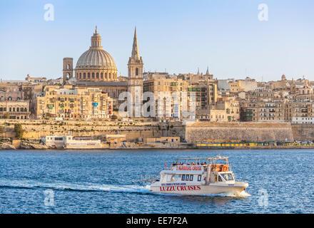 Valletta Skyline and Tourist Boat Marsamxett Harbour Valletta Malta EU Europe - Stock Photo