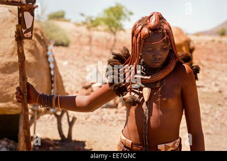 A young woman belonging to the indigenous Himba people pictured in her village in northern Namibia. - Stock Photo