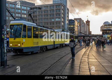 Tram stops at Alexanderplatz at sunset, Mitte, Berlin