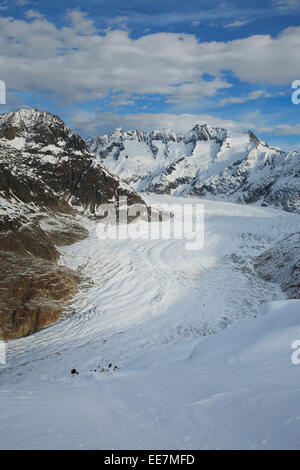 View over snow covered mountains in winter surrounding the Swiss Aletsch Glacier, largest glacier in the Alps, Switzerland - Stock Photo