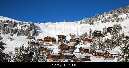 Swiss wooden chalets in the snow in winter in the Alps at the mountain village Riederalp, Wallis / Valais, Switzerland - Stock Photo