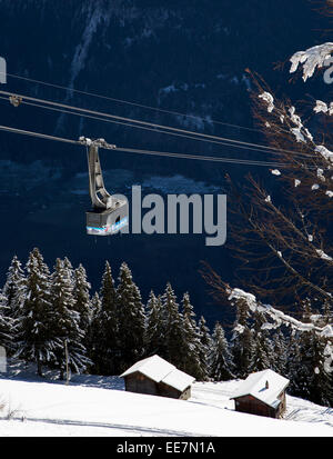 Gondola lift and view over the mountains in the snow in winter in the Swiss Alps at Riederalp, Wallis / Valais, - Stock Photo