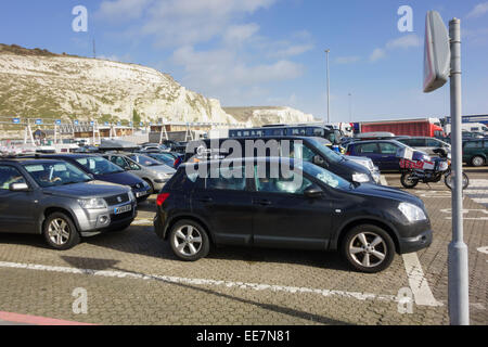 Cars queued up waiting for ferry to travel across English Channel from Dover port with white cliffs. Dover Kent - Stock Photo