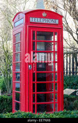 Red telephone box next to St Paul's Cathedral. London, UK - Stock Photo