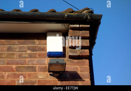 House Alarm Box and Halogen Security Lighting on an Exterior House Wall, UK PROPERTY RELEASED - Stock Photo
