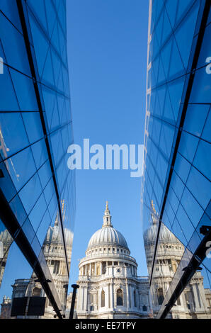 St Paul's Cathedral reflected in the glass of One New Change shopping centre. City of London, UK - Stock Photo