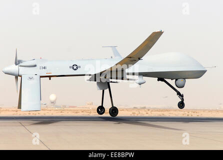 MQ-1 Predator unmanned aerial vehicle (UAV) takes off in Southwest Asia. See description for more information. - Stock Photo
