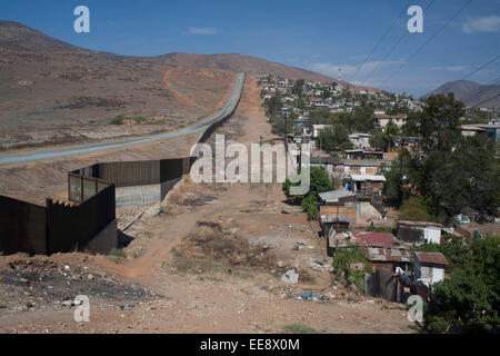 The US-Mexican border line from Tijuana in Mexico. - Stock Photo