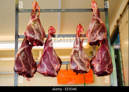 meat for sale on a market stall - Stock Photo