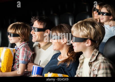 Happy Families Watching 3D Movie In Theater - Stock Photo