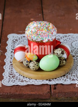 Easter cake with glace icing decoration and coloured easter eggs on a stock photo royalty free for Decoration glace