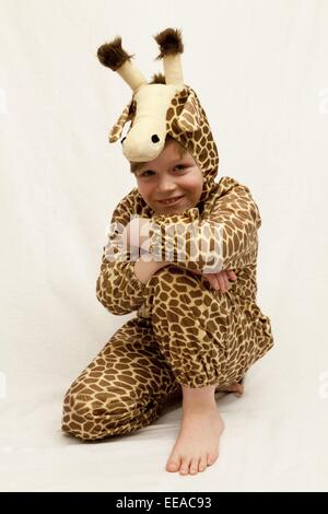young boy dressed up as a giraffe - Stock Photo