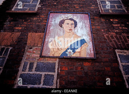 BELFAST, NORTHERN IRELAND - SEPTEMBER 1971.Portrait of Queen Elizabeth the Second mural painted on a wall in Loyalist - Stock Photo
