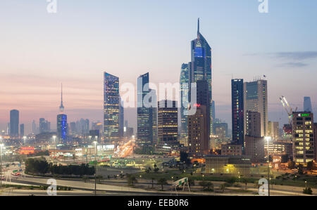 Skyscrapers downtown in Kuwait City at night - Stock Photo