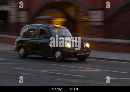 England, Manchester, black cab - Stock Photo