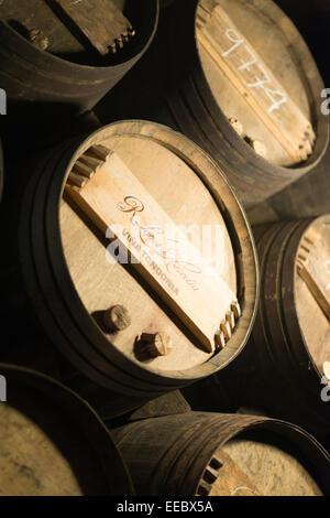 Wooden wine barrels in the cellar at the Bodega R. Lopez de Heredia tondonia in Haro Rioja Spain - Stock Photo