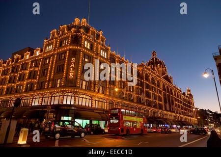 Harrods Department Store at night, Knightsbridge, London England UK - Stock Photo