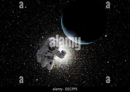 Artist's concept of an astronaut floating in outer space. An Earth-like planet sees sunrise in the background. - Stock Photo