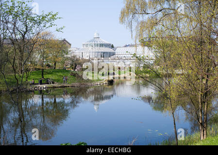 Botanical Garden in Copenhagen on a sunny day in spring with glass house - Stock Photo