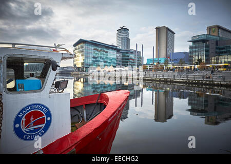 Lowry Outlet at Media City in Salford Quays, Manchester Cruises boat moored in the basin. - Stock Photo
