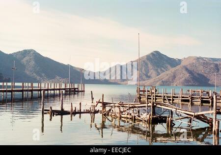 Wooden piers on the shores of lake Chuzenjiko near ancient town of Nikko, Japan. - Stock Photo