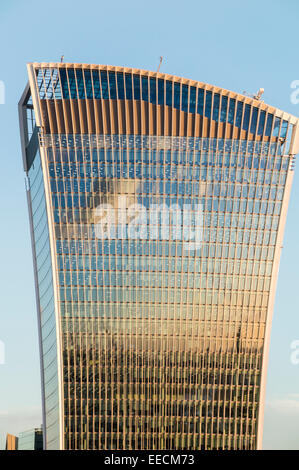 Reflection of evening clouds in the top of the Walkie Talkie Building, 20 Fenchurch Street, in the City of London, - Stock Photo