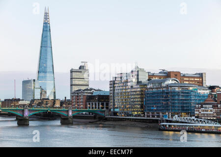 South Bank cityscape with the Shard, Riverside House and Southwark Bridge over the River Thames, London, UK - Stock Photo