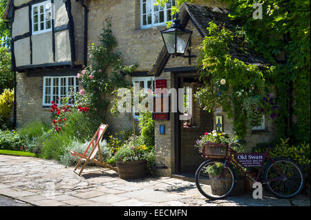 The Old Swan Hotel and Public House in Minster Lovell in The Cotswolds, Oxfordshire, UK - Stock Photo