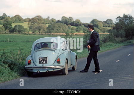 COUNTY TYRONE, UNITED KINGDOM-SEPTEMBER 1980. RUC, Royal Ulster Constabulary, police on Vehicle Stop during the - Stock Photo