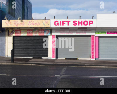 closed, out of season, gift shops and rock shops in a British seaside resort - Stock Photo