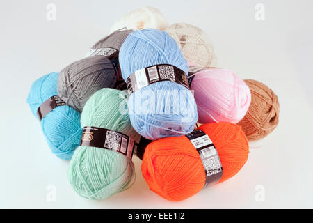 Pile of different coloured balls of double knitting wool - Stock Photo