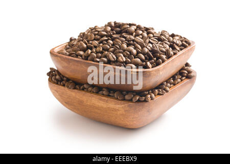 the coffee beans in wooden bowl - Stock Photo