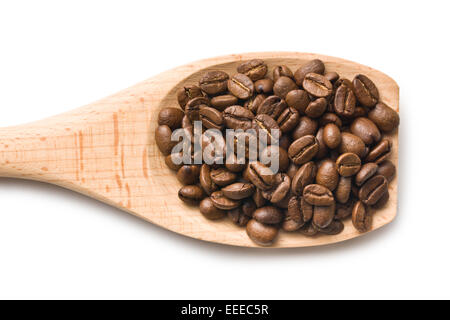 the coffee beans in wooden spoon - Stock Photo