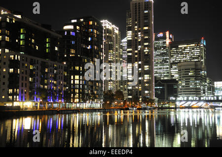 London Canary Wharf at night, reflections in Millwall Inner Dock - Stock Photo