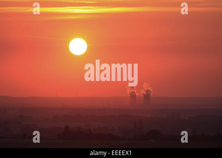 sunset with a red-orange sky at the german nuclear power station Grafenrheinfeld in Baveria, photo: June 10, 2008. - Stock Photo