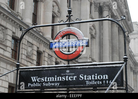 Westminster London Underground station sign in the snow - Stock Photo
