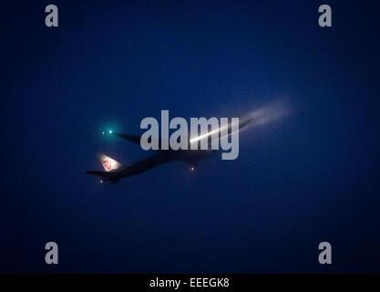 Frankfurt, Germany. 14th Jan, 2015. An aircraft of Air China arrives at night at the airport in Frankfurt, Germany, - Stock Photo