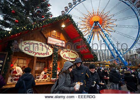 Ferris wheel and currywurst at the Christmas market in front of the Neptunbrunnen fountain, Alexanderplatz, Berlin. - Stock Photo