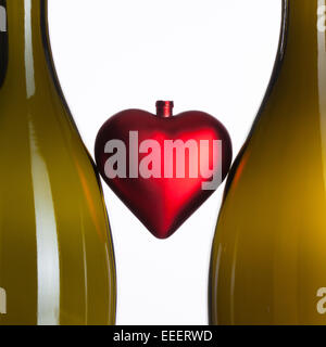 Empty bottles of wine and red heart - Stock Photo