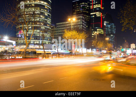 Business district of Istanbul at night near Kanyon shopping center, Levent - Stock Photo