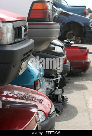 scrap cars in scrap yard, ready for dismantle, salvage or recycle, - Stock Photo