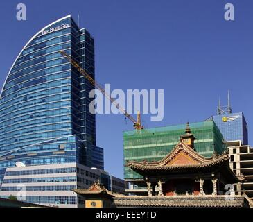 New hotel and Choijin Lama Museum in the capital city Ulaanbaatar,Mongolia - Stock Photo