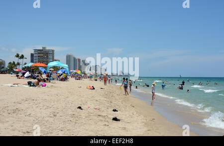 Fort Lauderdale, USA - May 19, 2013: Tourists and locals enjoy a sunny day on Fort Lauderdale Beach, Florida. - Stock Photo