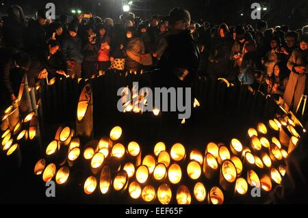 Kobe, Japan. 17th Jan, 2015. People light candles for the victims of the Great Hanshin Earthquake during a ceremony - Stock Photo
